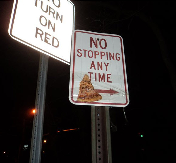 Pizza taped to sign